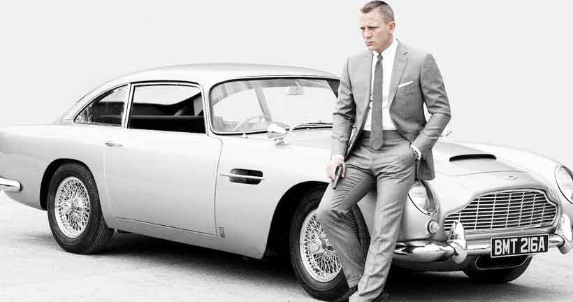 Daniel Craig who has played James Bond in four films poses with his DB5 for 'Sky Fall' Photo: Sony