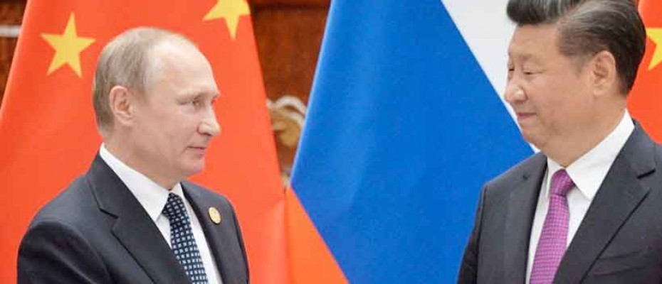 China's President Xi Jinping and Russian President Vladimir Putin meet at the 2018 Eastern Economic Forum in Vladivostok
