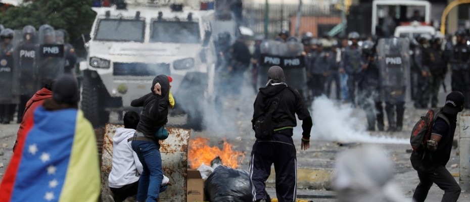 Protesters clash with police forces in Venezuela